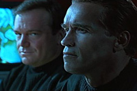 Tom Arnold and Arnold Schwarzenegger in True Lies
